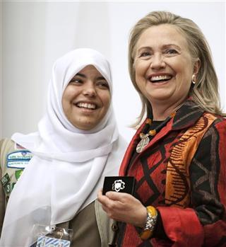 Girl Scout Ambassador Abrar O with Secretary of State Hillary R. Clinton