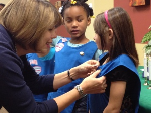 Lidia Soto-Harmon pins a Girl Scout Daisy
