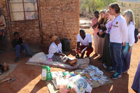 Distributing food and hygiene kits in village